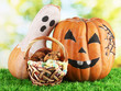Halloween pumpkins on grass on bright background