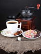 White cup of Turkish coffee with rahat delight, coffee pot and
