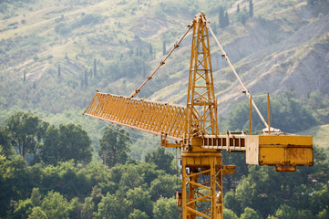 Building crane with hills on background