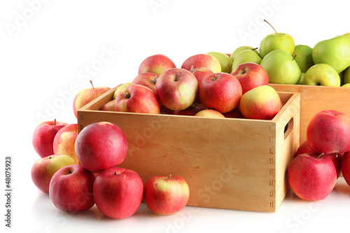 juicy apples in wooden crates, isolated on white