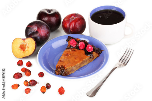 Tasty pie on blue plate with plums isolated on white