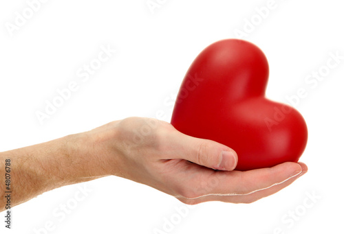 Red heart in man hand, isolated on white