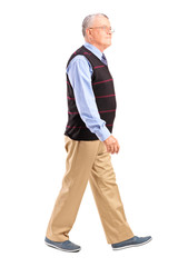 Full length portrait of a senior man walking