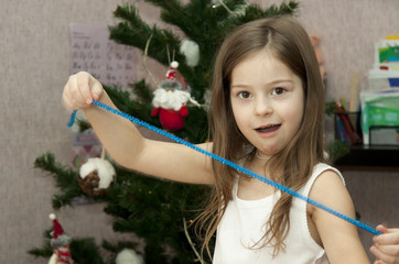 child with decorates a fur-tree