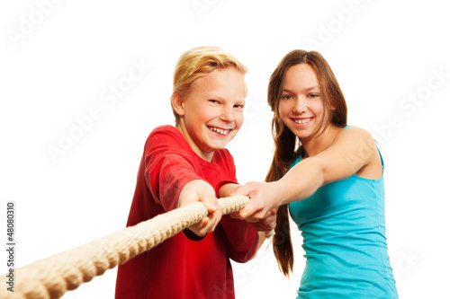 Two kids pulling the rope