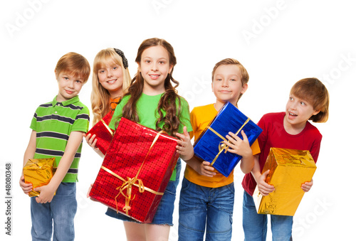 Cute kids with wrapped boxes