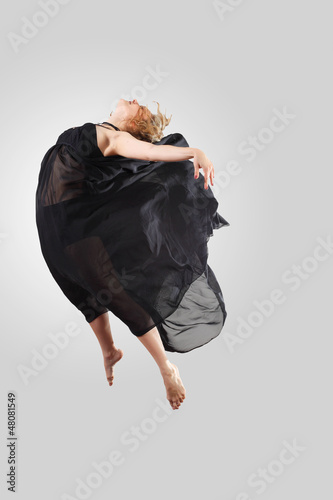 Young female dancer jumping