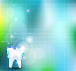 Beautiful blue background with healthy white tooth