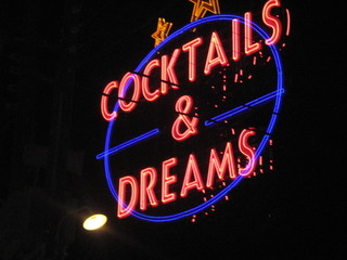 neon text  cocktails and dreams