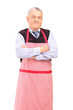 A portrait of a gentleman wearing apron and posing