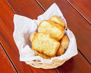 Garlic bread on a wood table