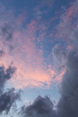 dark grey clouds on pink sunset