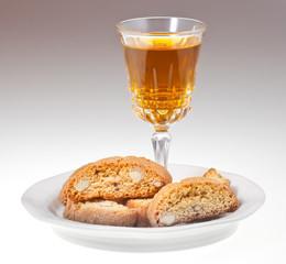 wineglass italian cantuccini on saucer