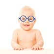 Happy smiling baby in glasses.