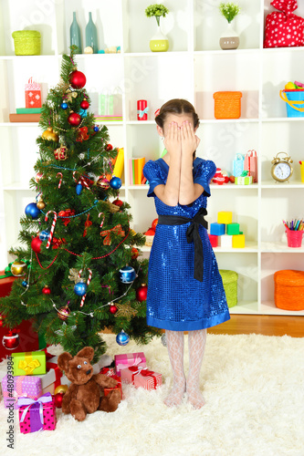 Little girl waiting her christmas gifts