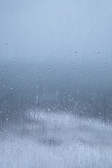 Rainy Holiday? Raindrops on window pane - bad weather