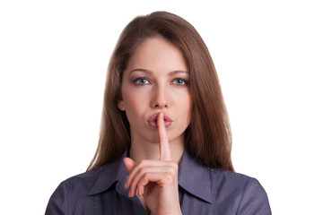Woman calls for silence, finger on lips