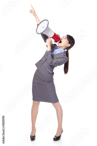 Business woman with megaphone yelling and pointing