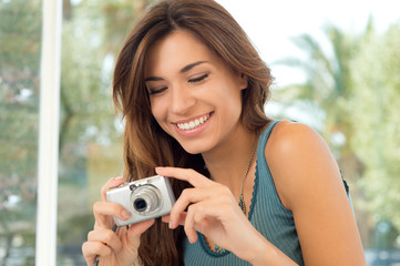Happy Woman Taking Pictures