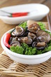 Chinese fried shiitake mushrooms in a bowl with parsley