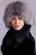 Beautiful woman in a fur hat and coat