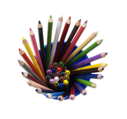 crayons and pencils in a blue cup, isolated