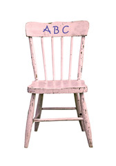 small pink wooden chair with abc, isolated