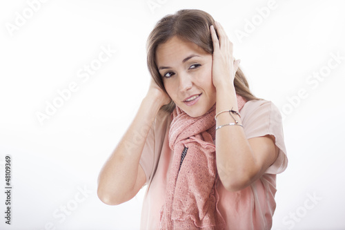 Young woman annoyed by so much noise
