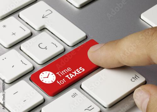 Leinwanddruck Bild Time for taxes keyboard key. Finger