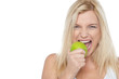 Closeup shot of a blonde woman biting an apple