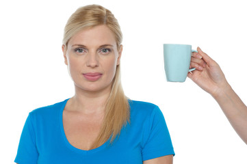 Woman is being offered a cup of beverage
