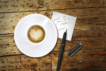 Heart coffee, with pen and notes, whait for you for a coffee