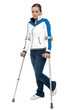 Pensive looking woman using crutches to walk