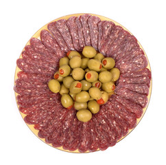 flat sausage in plate garnished with olives