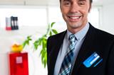 Entrepreneur with credit card in his blazer pocket