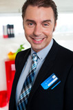 Cheerful male business executive in formals