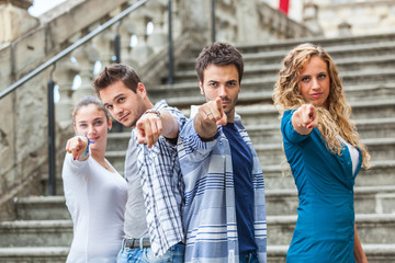 Group of Friends pointing at Camera