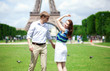 Closeup of happy positive couple dancing near the Eiffel tower