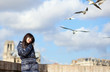Happy brunette girl in Paris enjoying windy spring day, sea-gull