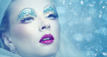 Lady Winter. Seasonal female portrait with snowflakes