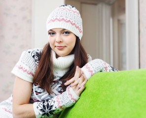 girl in knitted hat relaxing at home