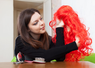 brunette woman with red wig