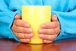 hands holding mug of hot drink close-up