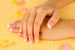 woman's hands on yellow terry towel, close-up