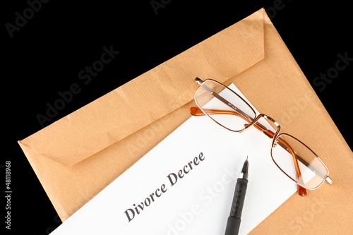 Divorce decree and envelope on black background
