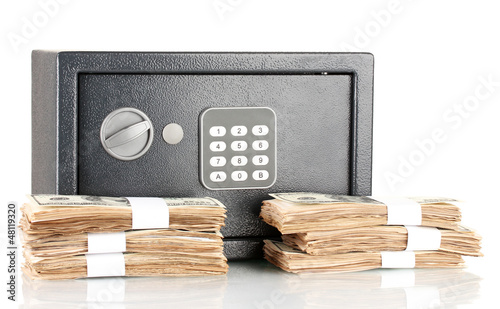 American dollars and safe isolated on white