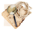 Old paper with magnifying glass and rope isolated on white