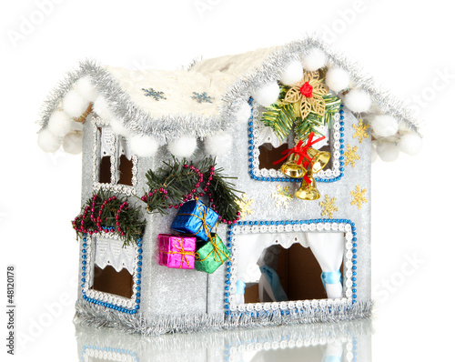 Decorated Christmas house isolated on white