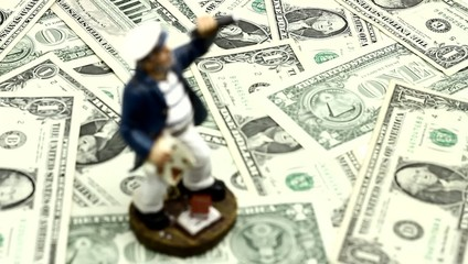 Follow focus on paper money and figure. Paths in economy.