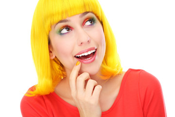 Woman with yellow wig looking up